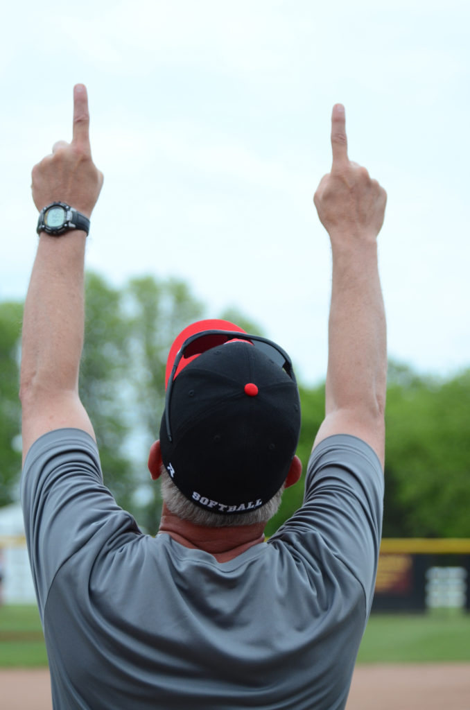 Columbiana coach Jerry Beltempo points to the sky after the Clippers defeated Springfield 7-4 in the Div. IIIdistrict semifinal on Thursday at South Range High School. (Salem News/Patti Schaeffer)