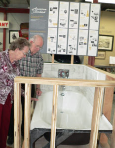 Winnie and Bob Stratton of Salem visit the new American Standard Americast bathtub display inside the Industrial Exhibit at the Dale Shaffer Research Library operated by the Salem Historical Society & Museum. Both Strattons worked at American Standard, Bob as a tool & die maker and Winnie as the telephone board operator. The museum is open for tours from 1 to 4 p.m. Sundays through October and from 6 to 9 p.m. the third Tuesday of each month. The library and gift shop are also open from 9 a.m. to noon Monday, Wednesday and Thursday. (Salem News photo by Mary Ann Greier)