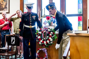 Sgt. Ryan Rhodes, left, and Don Sheen place the wreath. The event featured speakers state Rep. Tim Ginter and Rhodes. (Salem News photo by Wayne Maris)