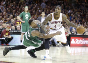 Cleveland Cavaliers' Iman Shumpert (4) drives on Boston Celtics' Marcus Smart (36) during the second half of Game 3 of the NBA basketball Eastern Conference finals, Sunday, May 21, 2017, in Cleveland. (AP Photo/Tony Dejak)