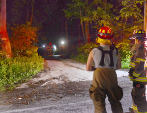 East Palestine and New Waterford firefighters donned their turnout gear complete with air packs and hiked about a quarter-mile up a narrow driveway to fight a basement fire at 4987 Peace Valley Road Saturday night. (Salem News photo by Patti Schaeffer)