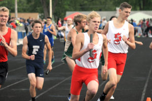 Salem's Josh Andrews receives the baton from Trey Double in the boys 3200-meter relay at the Div. II Austintown regional on Thursday. (Salem News/Ron Firth)