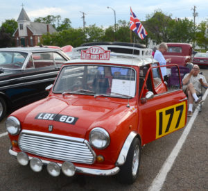 James P. Coco of Medina shows off his 1967 Mini Cooper at the Salem Super Cruise on Friday. (Salem News/Patti Schaeffer)