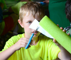 Seven-year-old Tyson Jackson of Pack 3 in Salem works at cutting the fins of his rocket as part of the rocket launcher art project. (Salem News photo by Patti Schaeffer)