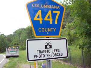A traffic camera warning sign is affixed to the county's sign for county Road 447, Dresden Avenue, in Liverpool Township. (Special to the News/county engineer's office)