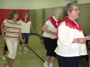 Marcia Snyder of Salem Senior Citizens joins Starbright Dancers, from left, Debbie Barker, Maureen Busch and Carol Herron for the Electric Slide. Behind Snyder is dancer Shelley Baumgartner.