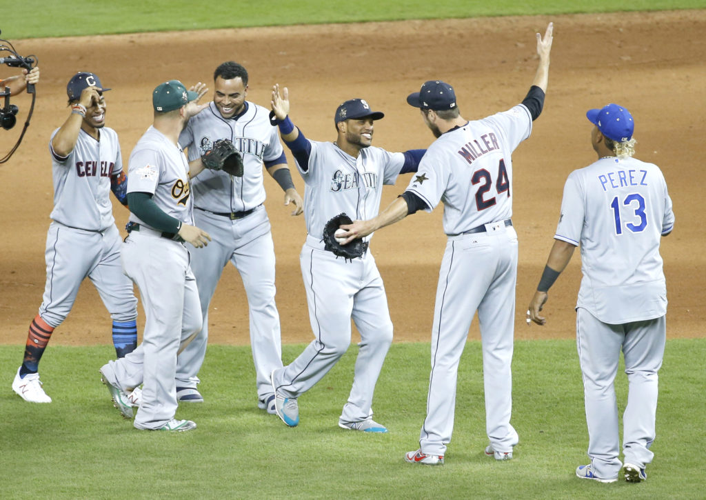 American League teammates celebrate winning the MLB baseball All-Star Game, Tuesday, July 11, 2017, in Miami. The American League defeated the National League 2-1 in ten innings. Seattle Mariners Robinson Cano (22), third from right, hit the game winning home run. (AP Photo/Wilfredo Lee)