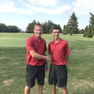 Columbiana golf coach Jeff Jackson (left) shakes the hand of Columbiana senior Jared Wilson on Monday after Wilson broke Jackson's school Valley Golf Club record with a 28. Wilson also now holds the Valley Golf Club course record. (Submitted Photo)