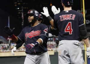 Cleveland Indians' Bradley Zimmer, right, congratulates Austin Jackson on his three-run home run off Minnesota Twins relief pitcher Buddy Boshers in the seventh inning of a baseball game Tuesday, Aug. 15, 2017, in Minneapolis. The Indians won 8-1. (AP Photo/Jim Mone)