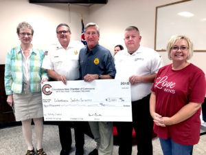 Columbiana Area Chamber of Commerce executive director April Brinker, right, and chamber director Deann Davis, left, presented the city's safety forces with $1,000 each for the police, fire and EMS departments. The donation is from the chamber's safety council to recognize the department's services to the community. Accepting the money is, from left, fire Chief Rick Garrity, police Chief Tim Gladis and EMS Coordinator Tom Farley. (Salem News photo by Katie White)