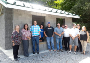 A ceremony was held last week officially dedicating the new restrooms at Willow Grove Park in Lisbon. From left are Councilwoman Cheryl Mills, Village Fiscal Officer Tracey Wonner, Parks Committee Chairman Jeff Snyder, Parks Manager Dana Blackburn, Brock Beatty of Numbers Brewery, contractor Gary Dailey, Lisbon Area Chamber of Commerce President Susan Shank, police Chief Mike Abraham, Councilman Vito DiIullo, police Sgt. Shar Daub, and Alisa Hall, the mayor's secretary. Not shown is Mayor Joe Morenz, who took the photo. (Submitted photo)