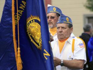 Members of the Columbiana American Legion lead off the Columbiana Street Fair parade.