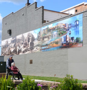 A 60-foot mural completed by nationally known artist Ray Simon is now on display in the Main Street Common in Columbiana. (Salem News photo by Patti Schaeffer)