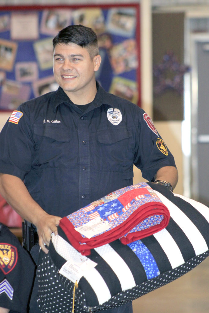 Salem police officer Mike Garber received a K-9 bed for his partner K-9 Simon and a quilt. (Salem News photo by Deanne Johnson)