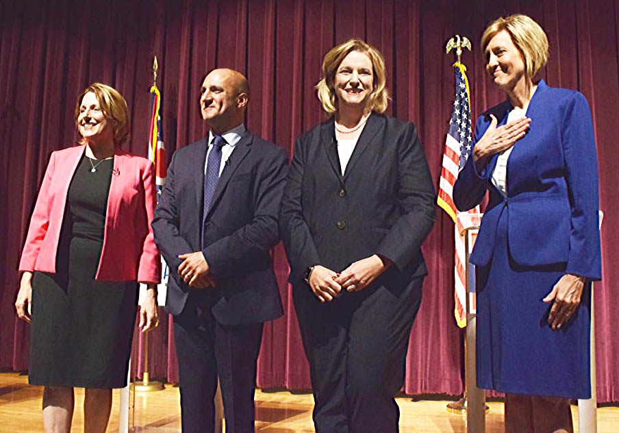 Ohio Democratic gubernatorial candidates posing for a photo at center stage after their first debate Tuesday at Martins Ferry High School, from left, are former state Rep. Connie Pillich; Ohio Sen. Joe Schiavoni, D-Boardman; Dayton Mayor Nan Whaley; and former U.S. Rep. Betty Sutton. (Special to the Salem News)
