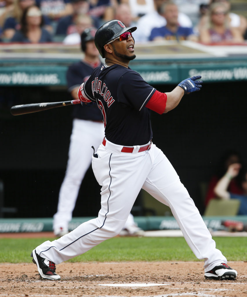 Cleveland Indians' Edwin Encarnacion hits an RBI single off Detroit Tigers starting pitcher Buck Farmer during the third inning in a baseball game, Wednesday, Sept. 13, 2017, in Cleveland. (AP Photo/Ron Schwane)