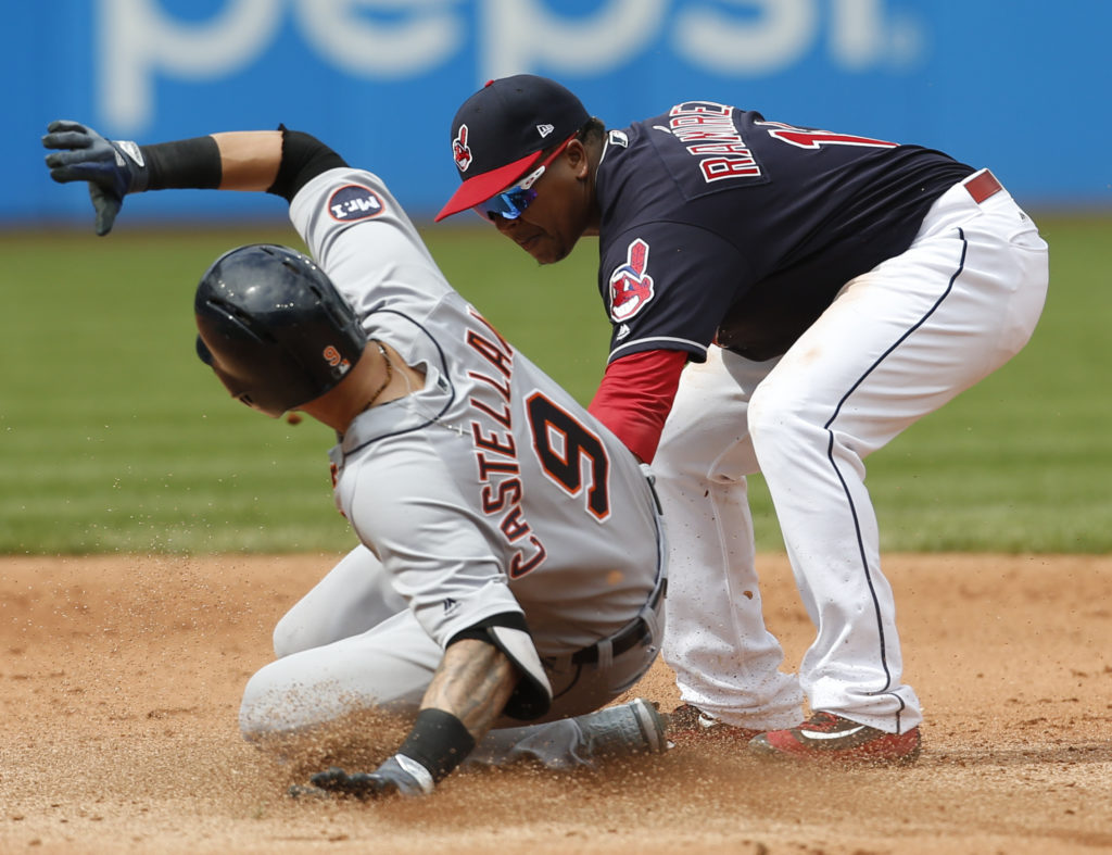 Detroit Tigers' Nicholas Castellanos slides safely into second base with an one run double as Cleveland Indians' Jose Ramirez covers during the sixth inning in a baseball game, Wednesday, Sept. 13, 2017, in Cleveland. The Indians defeated the Tigers 5-3 and set the American League record with 21 consecutive wins. (AP Photo/Ron Schwane)