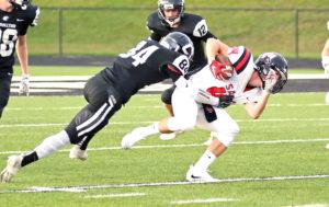 Salem's Brock Baddeley returns the opening kick as Carrollton's Trevor Boggerty makes the tackle.