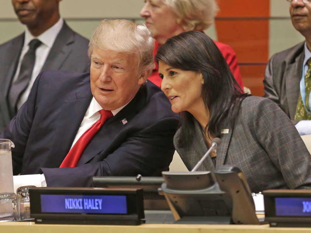 President Donald Trump speaks with U.S. Ambassador to the United Nations Nikki Haley before a meeting during the United Nations General Assembly at U.N. headquarters Monday. (AP Photo)