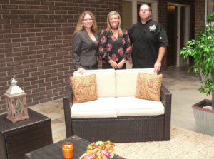 The Stables Inn & Suites at the Timberlanes Complex on Pershing Street in Salem hosted an open house with the Salem Area Chamber of Commerce Wednesday to reveal the completed renovation of the first floor of the former motor inn. Shown in the Atrium are hotel manager Jackie Bader, owner Brandy Pidgeon and Boneshakers/Timberlanes Complex Chef Eric Carcione. Not pictured is owner Brooke Pidgeon. The hotel is now taking reservations at 234-567-4671, with 21 rooms ready on the first floor.