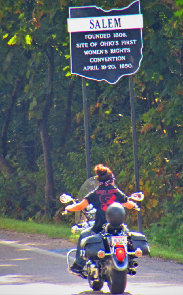 """A motorcyclist enters Salem on North Lincoln Avenue Wednesday past one of four """"First Women's Rights Convention"""" historical markers placed at the entrances to the city. The markers commemorate Salem's place in history as being the home to Ohio's first Women's Rights Convention, the third nationally, held at the Wilbur Friends Meeting House in the 300 block of East 6th St., on April 19-20, 1850. (Salem News photo by Larry Shields)"""