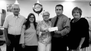 Representatives of Bunker Hill United Methodist Church presented a check to West Branch Local Schools in the amount of $1,506 to help assure that students in West Branch aren't going hungry at lunch time. Pictured are members of the church's Mission Committee, from left, Paul Manypenny, Cindy Kaurich and Pat Coy; and from West Branch Local Schools, David Drawl, treasurer; and Lorrie Weingart, director of food services. Absent was committee member Dolores Campbell. (Submitted photo)