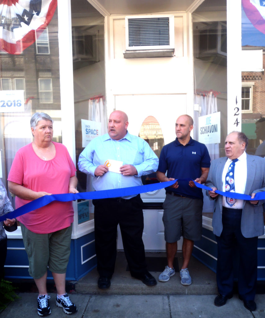 Columbiana County Democratic Party Chairman Nick Barborak, second from left,  says a few words before cutting the ribbon to celebrate the remodel at party headquarters in Lisbon on Saturday. Shown with him from left are Patty Colian, state Sen. Joe Schiavoni and Hall of Fame Central Labor Council, AFL-CIO President Dan Sciury. (Submitted photo)