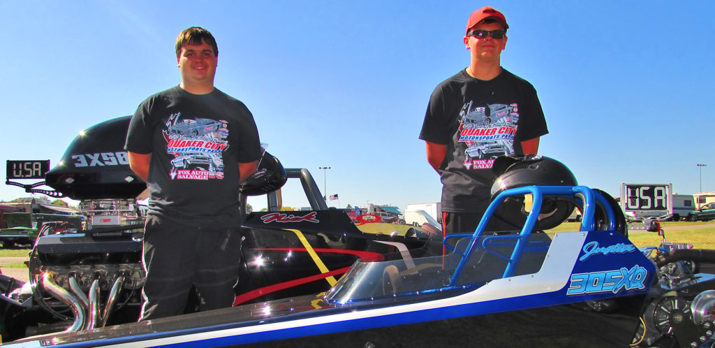 Two drag racers from Leetonia, Justin Greaver, 14, left, and his stepbrother, Nick Craig, 21, are the 2017 class champions at Quaker City Motorsports Park for 2017. The titles earned both of them a trip to the International Hot Rod Association World Finals in Memphis, Oct. 20-22. The sons of Scott and Tami Greaver, Justin is a freshman at Leetonia High School while Nick majors in mechanical engineering at Youngtown State University. The two are pictured during a test and tune session at Quaker City Motorsports Park on Saturday with Justin's junior dragster and Nick's top eliminator dragster in the back. (Salem News photo by Larry Shields)