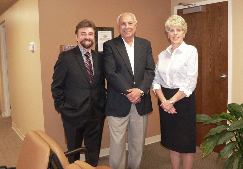 From left, Counseling Center Executive Director Roger Sikorszky gives a tour of the new Salem facility on Vine Avenue to Salem Community Foundation President John Tonti and SCF grants coordinator Melissa Costa. The SCF awarded the agency $25,000 to buy new furnishings for the space, including furniture, office equipment, a new security system and new phone system for the group room and staff break room. The move from the old location on North Lincoln Avenue allowed for an expanded space and expanded services. (Salem News photo by Mary Ann Greier)
