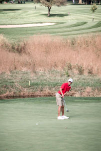 Columbiana's Jared Wilson putts in the Div. III state golf tournament on Friday at the Ohio State University Scarlet Course. (Submitted Photo)