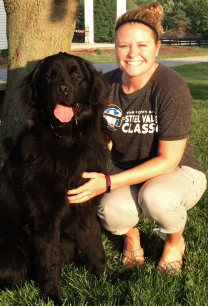 United High School guidance counselor Samantha Muniz is pictured with Rocco, a 1-year-old Newfoundland therapy dog she plans to provide the school. (Submitted photo)