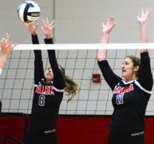 Salem's Laci Ewing (8) and Caitlyn Marx (11) go up to block an East Palestine attack on Saturday in a Div. III sectional volleyball at Salem High School