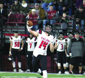 Salem's Mitch Davidson throws the ball against Steubenville on Friday night in a Div. IV playoff game at Harding Stadium. (Joe Catullo)