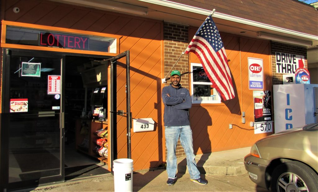 The owner of the Leetonia Market Drive Thru, Mihiar Albdour, stands in front of the newly re-opened convenience store at 433 Columbia St. It is his first business venture and he will be joined by Leetonia village officials at noon Monday for a ribbon-cutting and grand opening ceremony. (Salem News photo by Larry Shields)