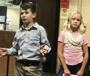 Fifth-grade students Jase Medure and Jenna Marhefka explain to the school board the elementary school's Leader in Me Program. This year the school has introduced standards-based report cards to help measure areas such as leadership. (Submitted photo)
