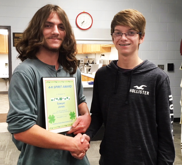 President William Reph, right, presents the 4-H Spirit Award to Rangers 4-H member  Sawyer Jones.  (Submitted photo)