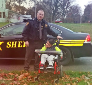 The Columbiana County Sheriff's Office will host its annual Stuff-A-Cruiser from 11 a.m. to 3 p.m. Nov. 21 at the Salem Walmart. Shown are Deputy Jon Price and his 8-year-old son Sebastian, who has been diagnosed with multiple disabilities including blindness, cerebral palsy, diabetes isipidus, seasoned disorders and more. (Submitted photo)