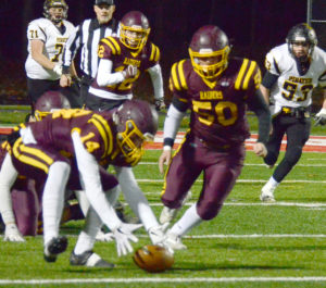 South Range's Aniello Buzzacco picks up a fumble and races 72 yards for a touchdown on Friday against Sullivan Black River in a Div. V playoff contest at Northwest High School. (Photo by Patti Schaeffer)