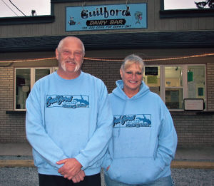 The Guilford Lake Dairy Bar owners Dave and Rhonda Hardesty said that with the addition of made-to-order pizza and a hot-food menu lineup they will operate the business year-round. Located at the state Route 172 and Hanna Drive corner, most of the summer ice cream treats will be sold along with hamburgers, hot dogs, fresh-cut fries, homemade batter-dipped fish and batter-dipped onion rings. Rhonda also owns Rhonda's Dawggy Pawlor, a dog grooming center on East State Street in Salem. Customers can call in an order at 330-222-2002. The number on the sign in the photo is incorrect. (Salem News photo by Larry Shields)