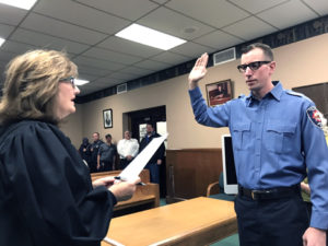 Andrew Wolfgangof Salem  left a teaching career to become an East Liverpool firefighter, with the oath administered Friday morning by Municipal Court Judge Melissa Byers Emmerling. (Salem News photo by Jo Ann Bobby-Gilbert)