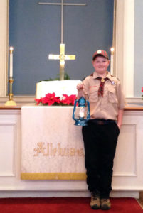 Noah Clark, 10, of the Columbiana Boy Scouts Pack 16, is a courier of the Peace Light which originated from the birthplace of Jesus Christ and is being shared all over the world. (Submitted Photo)