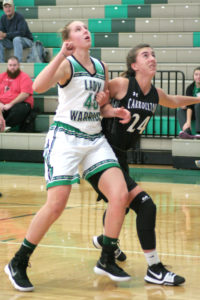 At left, West Branch's Shannon Wolfe battles for position during Saturday's game against Carrollton.