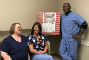 Doctors and staff from Ankle & Foot Care Centers are hoping to collect hundreds of pairs of shoes and socks for their 20th annual holiday shoe drive. From left are Terri Prentice, Tina Adkins and Dr. Kwame Williams at the Liberty office. (Submitted photo)