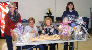 Junior Group of Goodwill members, from left, Ginnie Kernan, Barb Metzendorf, Patty Suchora and Sue Stingel, wrap baskets and price jewelry in preparation for the upcoming Junior Group of Goodwill Auction and Jewelry Sale. The event begins at 8 p.m. Feb. 16 at Stambaugh Auditorium in Youngstown. Doors open at 6:30 p.m. Tickets are available at any of the eight area Goodwill stores (Austintown, Boardman, Calcutta, Hermitage, Liberty, New Castle, Salem and Warren), at the Goodwill offices on Belmont Avenue in Youngstown, or online at goodwillyoungstown.org. (Submitted photo)