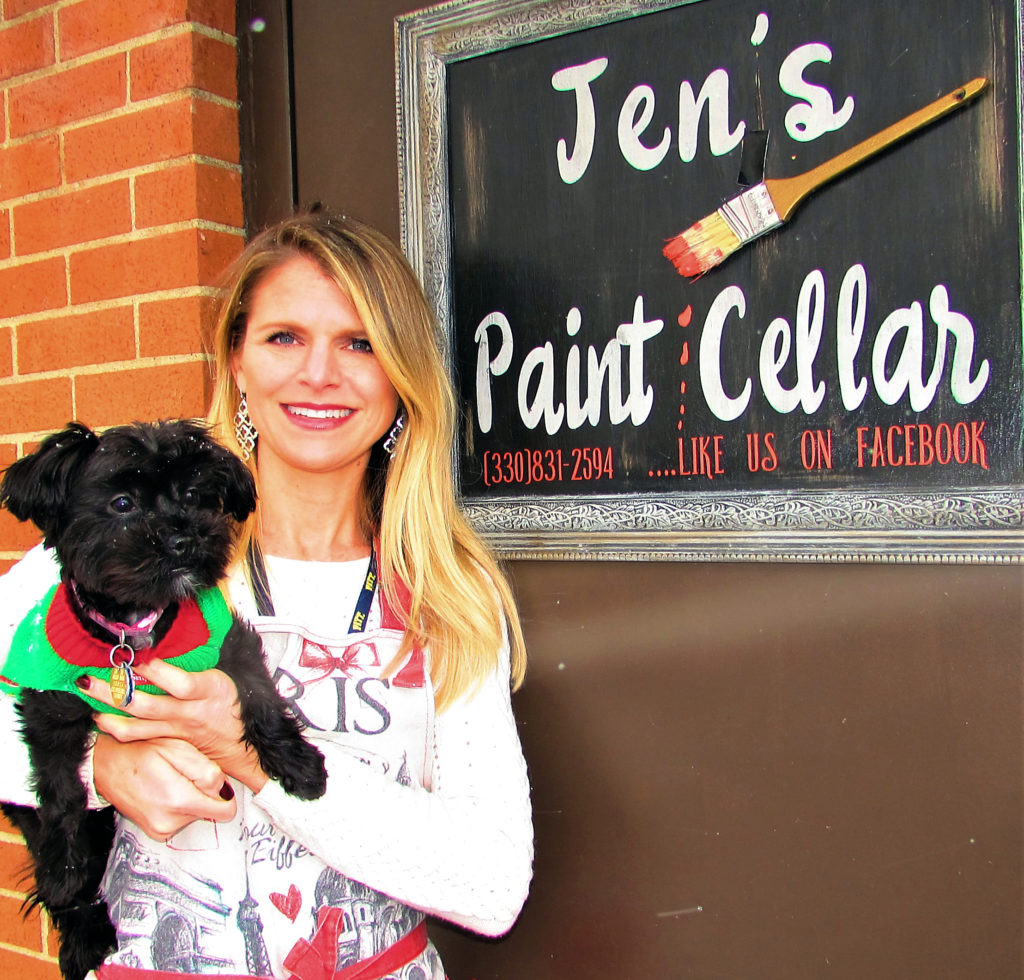 Jen Walter opened Jen's Paint Cellar last April and has developed a strong clientele for her creative workshops and the handmade merchandise she sells. Jen's Paint Cellar, located at 1068 E. State St., behind the AT&T store, is now open for winter hours from 11 a.m. to 3 p.m. on Tuesday and Friday. Walter is pictured at the entrance to her store with Lola, who is less than a year old and collecting a few snowflakes while posing. (Salem News photo by Larry Shields)