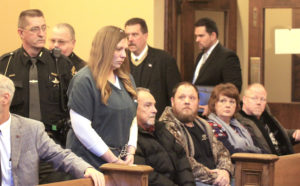 Brown in Columbiana County Common Pleas Court on Friday followed by deputies Bill McGee, Lt. Allan Young and Detective Jeff Haugh. (Salem News photo by Deanne Johnson)