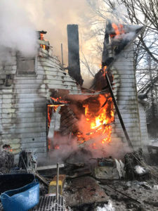 A roughly 100-year-old farm house on Pine Hollow Road was destroyed by fire Saturday. Crews from Negley, New Waterford, East Palestine and Lisbon spent more than seven hours extinguishing the flames. (Photos courtesy East Palestine Fire Department)