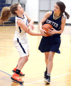 At left, Leetonia's Anna Buffone (10) vies with United's Kyleigh Daggy (11) for the ball on Thursday
