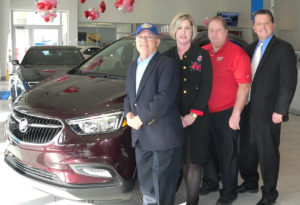 From left, Stadium GM Superstore owner Shorty Navarro, Salem Regional Medical Center Director of Development Amy Reed, Stadium GM Superstore General Manager Mike Hudock and SRMC Foundation Special Events Chairman George Morris III gather next to a 2018 Buick Encore SUV up for grabs through a foundation fundraiser. Stadium donated a two-year lease on the vehicle to help support the  hospital's continued growth and mission of serving the community and region. Raffle tickets are $50 each and can be purchased at the Stadium GM Superstore, the Look Nook gift shop and the SRMC Development office, both at SRMC. Tickets will be available in the SRMC cafeteria from 11 a.m. to 1:30 p.m. on Friday and on Feb. 23 and March 9. The drawing will be held during the Eighth Annual Hearts & Stars Gala on March 17 at the The Vineyards at Pine Lake in Columbiana. (Salem News photo by Mary Ann Greier)