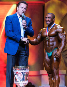 Arnold Schwarzenegger congratulates Ahmad Ashkanani, who won first place in the men's 212 Bodybuilding Competition competition at last year's Arnold Sports Festival. This year's event is scheduled for March 1 through 4 in Columbus. (Special to the Salem News/John Aguirre)